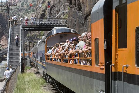 Visitors in an open car aboard the Royal Gorge Route