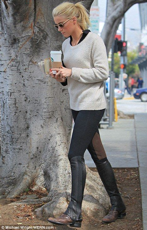 Amber Heard all equestrian chic wearing boots and half