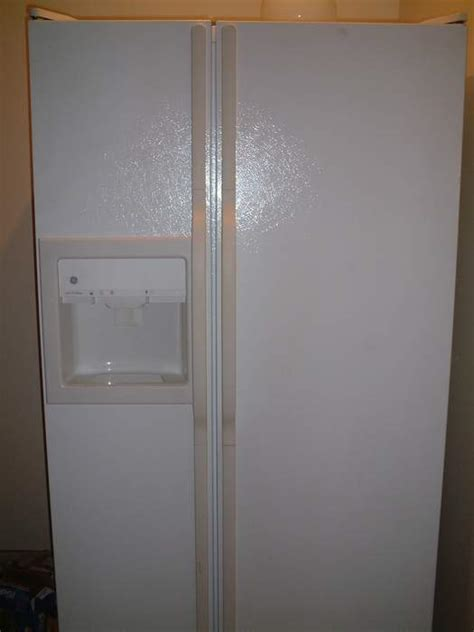 White GE side by side refrigerator freezer FOR SALE from
